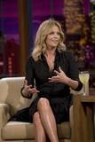 th_80407_Celebutopia-Charlize_Theron_appears_on_The_Tonight_Show_With_Jay_Leno-14_122_228lo.jpg